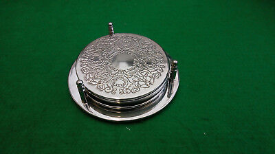 Vintage silver plated set of 4 coasters and wine bottle holder