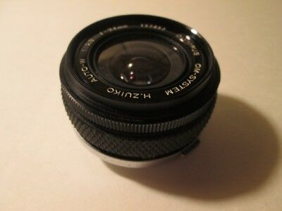 Olympus OM-system 24mm 2.8 Zuiko lens with case.