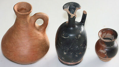 Three pottery jugs, possibly ancient Greek