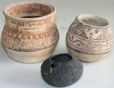 Three pottery vases including one with painted decoration, possibly ancient