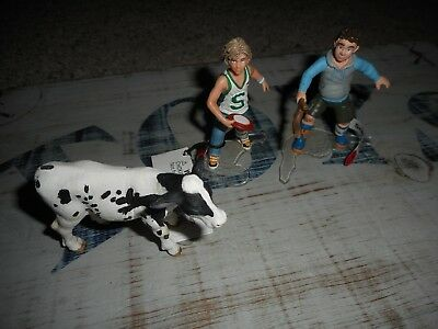 Schleich lot of 3 figures, cow calf, 2 boys Children playing  13903 13904 13634