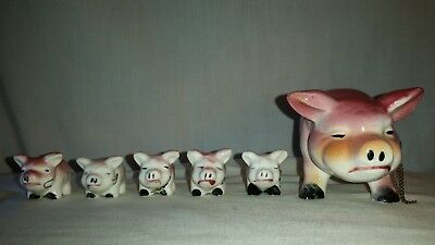 Vintage lot of 6 porcelain ceramic  pigs, a sow with five piglets chain-able