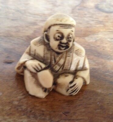 Carved Netsuke in the form of an Oriental Figure