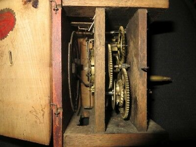 Small striking Black Forest clock movement in wooden case, good condition.
