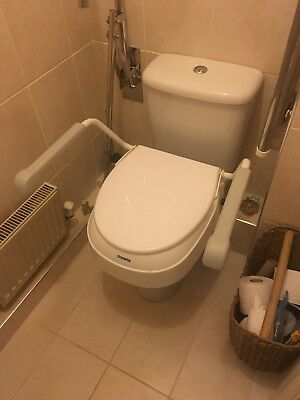disabled toilet seat with four height settings and support arms White very clean