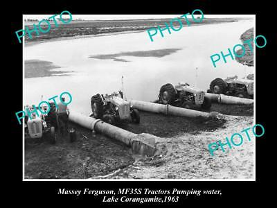 Old Large Historic Photo Of Massey Ferguson Mf35 Tractors Pumping Water 1963