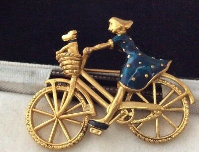 Vintage Jewellery delightful enamel girl riding bicycle with her dog brooch