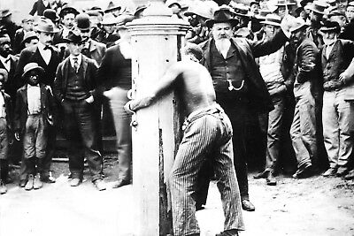 Negro Boy Looks in Horror as a Negro Slave is Beaten at a Slave Whipping Post