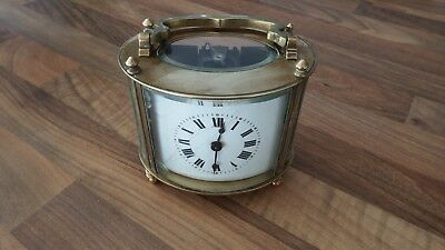 Rare Oval Cased Carriage Clock in working order, needing some tlc