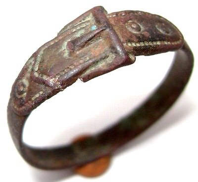 Ancient charming bronze ring in form of belt.