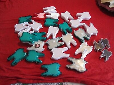 Lot of tooth shaped plastic boxes
