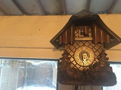 cuckoo clock with rabbits on in working condition