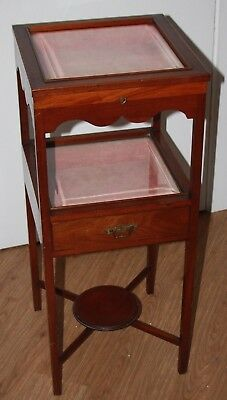 Antique small mahogany display cabinet with key