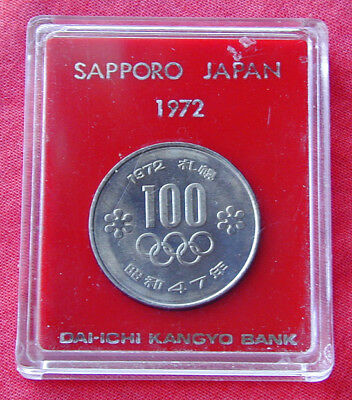 1972 Sapporo Winter Olympics 100 yen coin enclosed in hard plastic display holde
