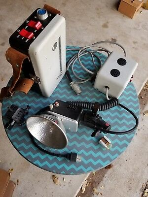 Norman 200B Portable Lighting Kit with one LH 2 Strobe Head and a charger