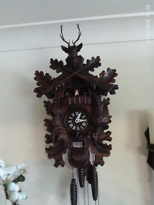 hunters vintage musical cuckoo clock with  Thorens movement made in Switzerland
