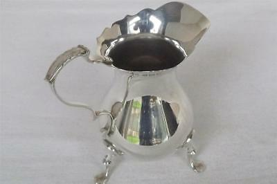 A Fine Solid Sterling Silver Georgian Style Cream Jug Of Helmet Form Dates 1932.