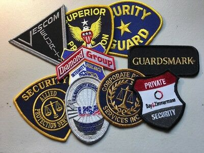 Lot Of Nine (9) Security Police Department Patches