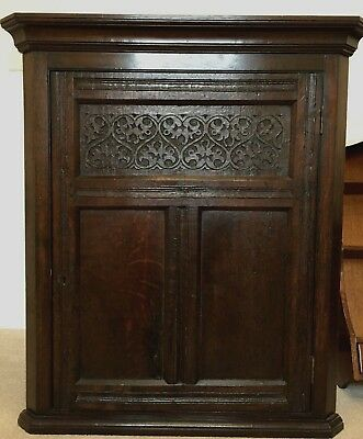 Oak Corner Cupboard with 17th Century Front Panel