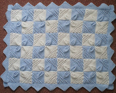 Beautiful hand knitted baby blue and  white pram/cot blanket