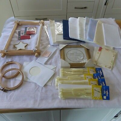 A Cross Stitcher's stash of assorted items. Aida fabric, embroidery frames etc.