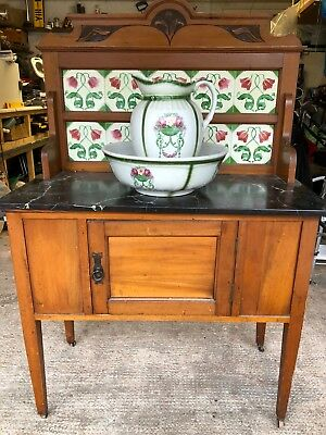 Victorian wash stand with jug and bowl.