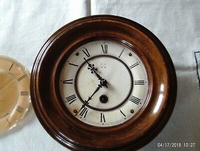 small antique wall clock,by camerer kuss &co