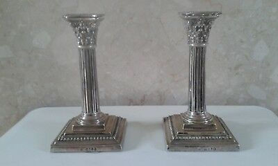 A Pair of Sterling Silver Corinthian Style Candlesticks