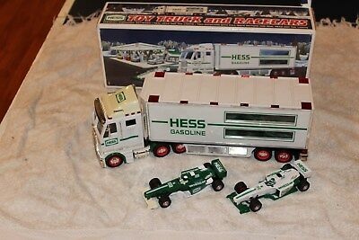 5PC Lot of Hess Trucks, race car, helicopter, motorcycle, airplane, fire truck