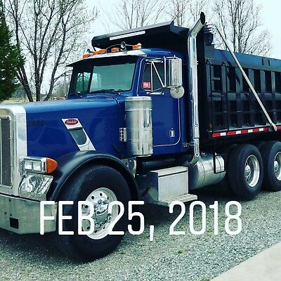 PETERBILT TRIAXLE  TRUCK with new bed gate and Hitch.