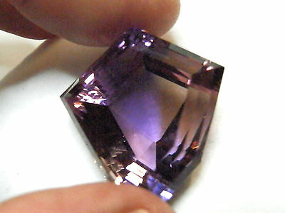 Natural earth-mined world class museum quality ametrine...76.9 carat