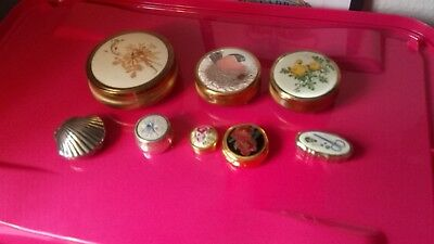 eight X trinket boxes. Also for pills.