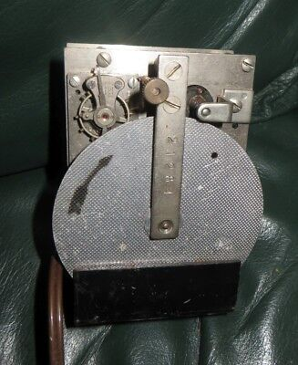Unusual electric clock movement with platform escapement