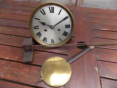 Vintage wall clock movement,pendulum and gongs.Working.