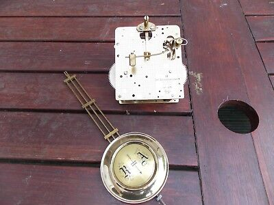 Wall clock movement and pendulum,spares/repairs.