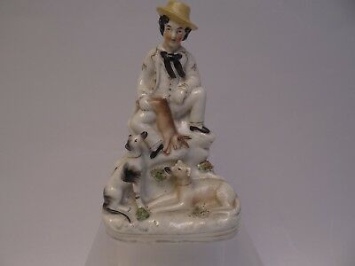 Flatback Staffordshire Pottery Figure of a Man and His Dogs
