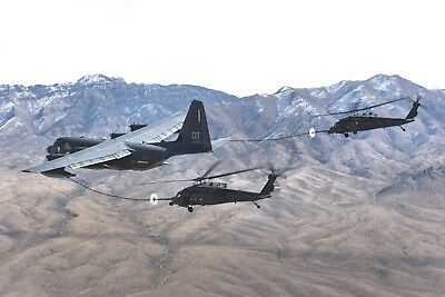 A Pair of HH-60 Pave Hawk Helicopters-Refueling from HC-130J Combat King