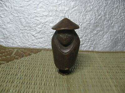 Japanese Netsuke Boxwood Man in Old Style Rain Wear carved in Edo era