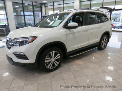 Honda Pilot EX-L AWD with Accessories EX-L AWD with Accessories New 4 dr SUV Automatic Gasoline 3.5L V6 Cyl White Diam