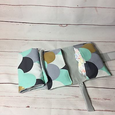 All in one diaper clutch and waterproof change mat in mint gold grey