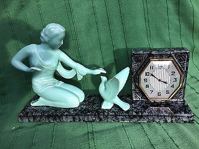 Art Deco Ceramic clock with Figure and dove by ODYV Vierzon France