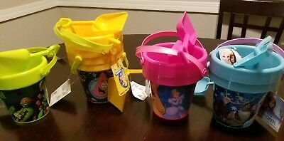 9 pc lot of New w/ tag , 2-pc Character Sand Buckets with shovel