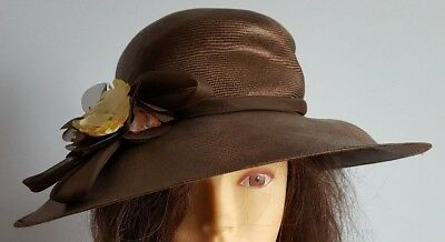 Brown vintage straw hat with hand trimmed yellow & peach silk flowers.