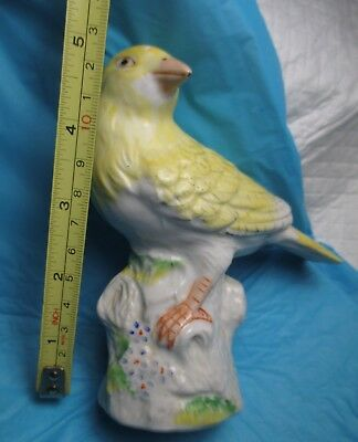 Vintage porcelain YELLOW Bird Figurine on tree trunk Finch signed collectible
