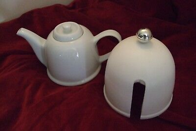 white ceramic teapot with thermal cover