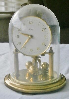 Koma small brass Anniversary Clock, glass dome, for spares or repair
