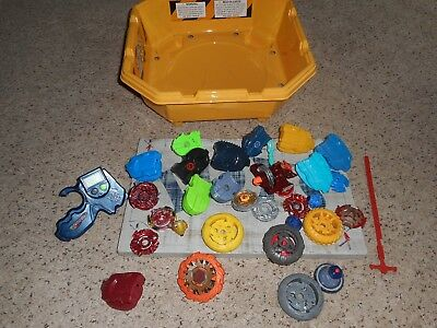 Beyblade Burst lot, with yellow arena and spinner parts, as is