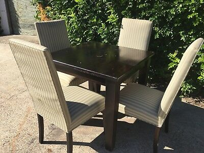 Five Piece Dining Set With Dark Wooden Table And Striped Fabric Chairs