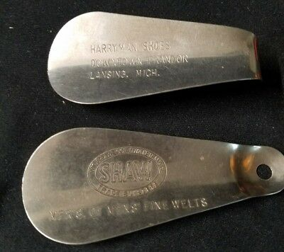 Vintage pair of metal shoe horns with Advertising Michigan Shaw Trade Builders