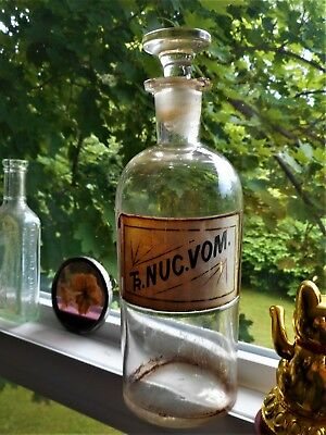 """USA Label Under Glass Apothecary """"TR. NUC. VOM.""""  HasTop of Lip Chips. 8 1/4""""."""